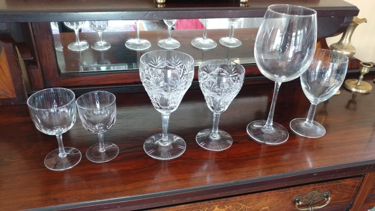 Wine glasses have gotten steadily bigger over the years. Left to right: wine glasses from the early 20th century; from 1968; from 2005