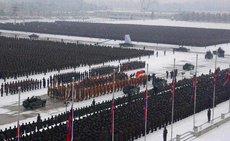 Image: The casket of former North Korean leader Kim Jong Il is carried through Pyongyang in December 2011.