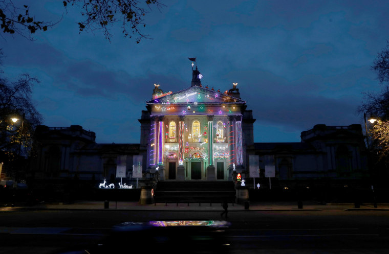 Image: Tate Britain's Christmas art commission, Home for Christmas by Alan Kane, is illuminated on the front of the gallery, in London