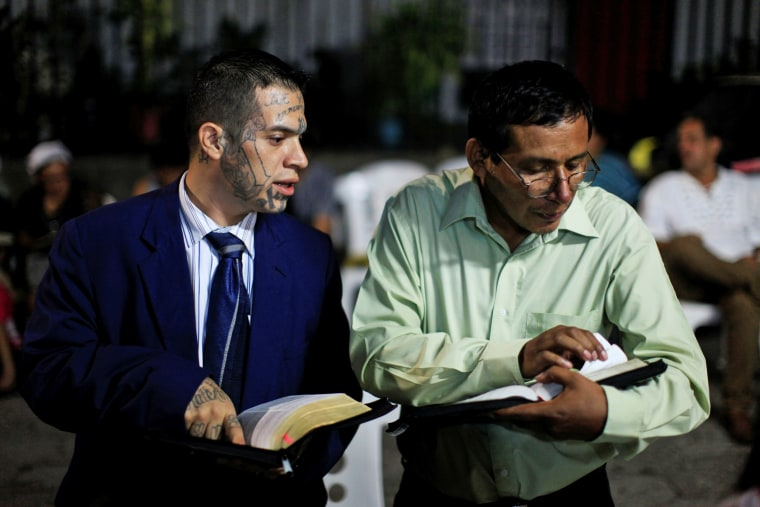 "Image: Julio Marroquin, (L), member of the ""Huellas de Esperanza"""