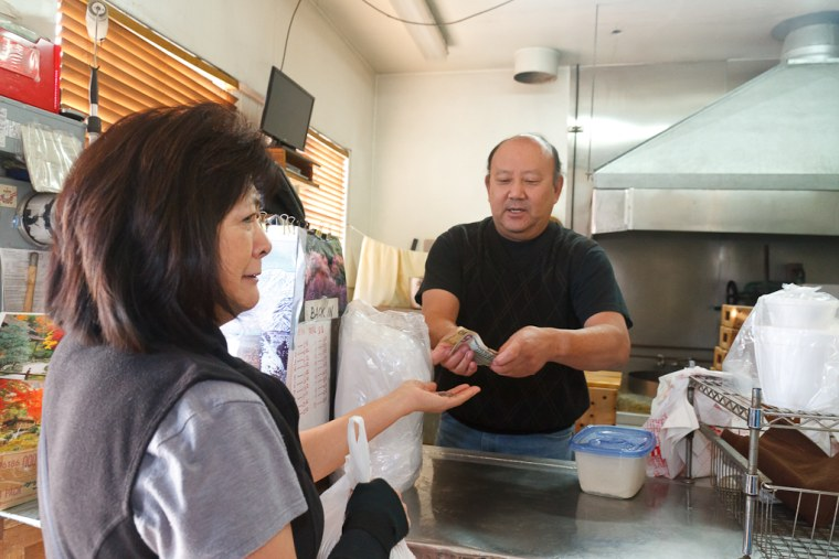Chester Nozaki banters with a customer at San Jose Tofu Company.