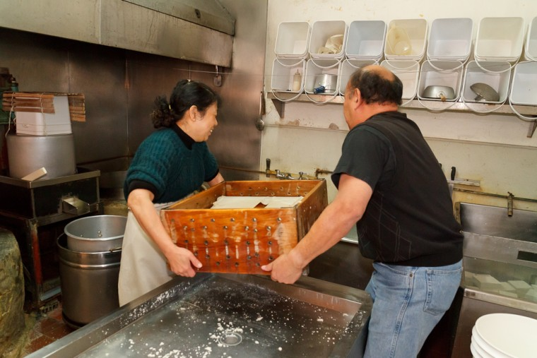 Chester and Amy Nozaki making tofu at San Jose Tofu Company. The couple plan to close the business by the end of the year.