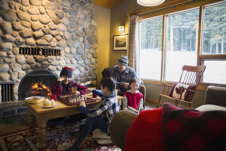 Image: Family playing chess in lodge living room