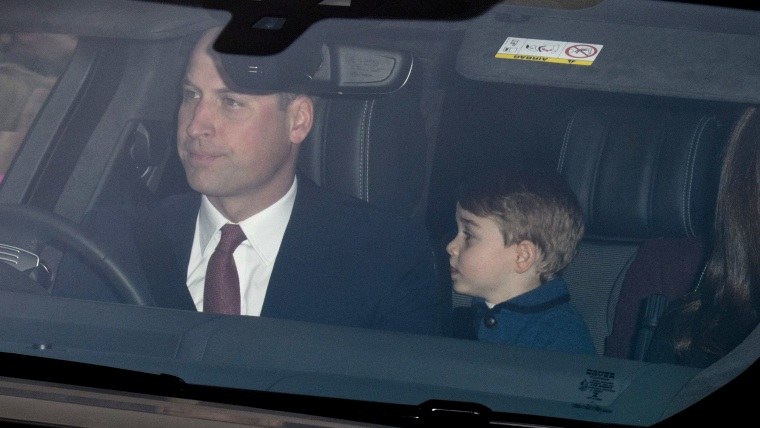Prince William and Prince George arrive at Buckingham Palace for queen's Christmas lunch.