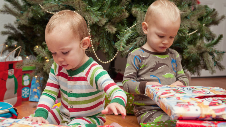 Brother and sister looking at Christmas presents