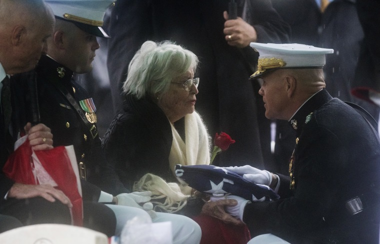 Image: Annie Glenn receives a flag at the funeral for husband John Glenn