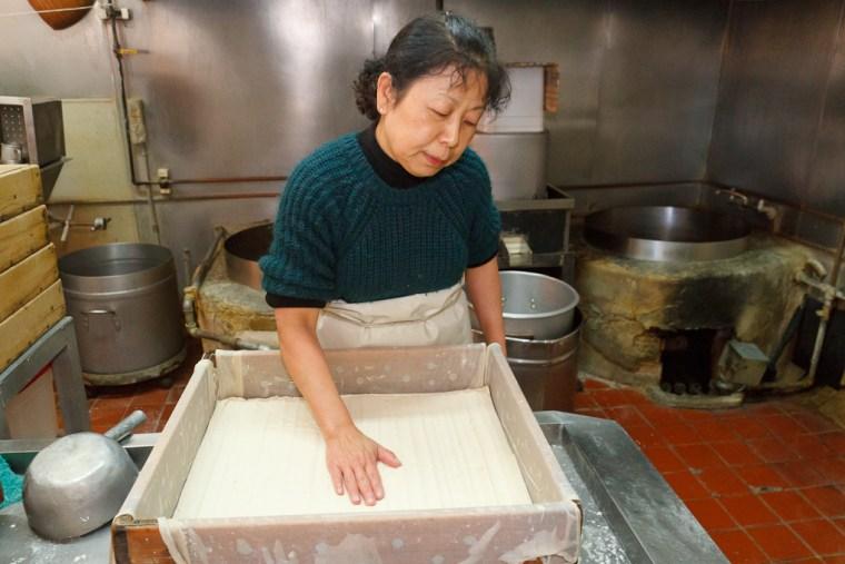 Amy Nozaki tests a batch of tofu at San Jose Tofu Company.