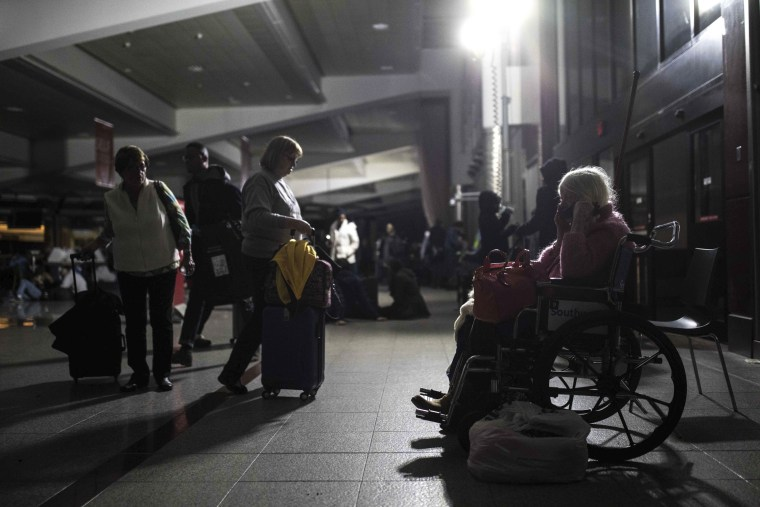 Image: Passengers wait after the lights went out at Hartfield-Jackson Atlanta International Airport, Dec. 17, 2017, in Atlanta.