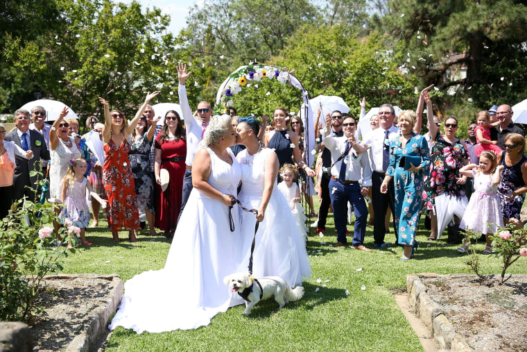 Image: Amy Laker and Lauren Price kiss after getting married in Sydney