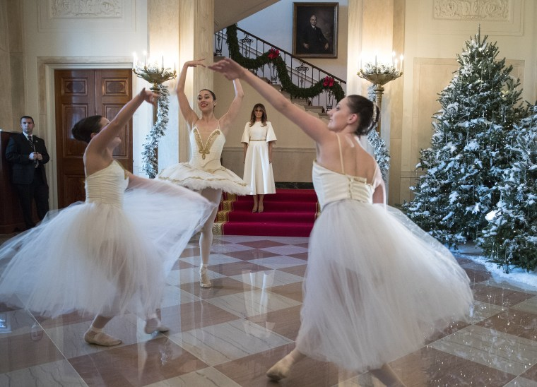 Image: First lady Melania Trump watches as ballerinas perform a piece from The Nutcracker among the 2017 holiday decorations in the Grand Foyer of the White House in Washington, on Nov. 27, 2017.