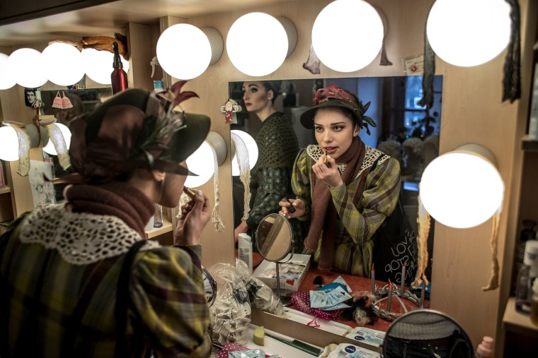 Image: Dancers apply make-up and add the finishing touches to their stage costumes in the performers' backstage wardrobe in Prague on Dec. 16.