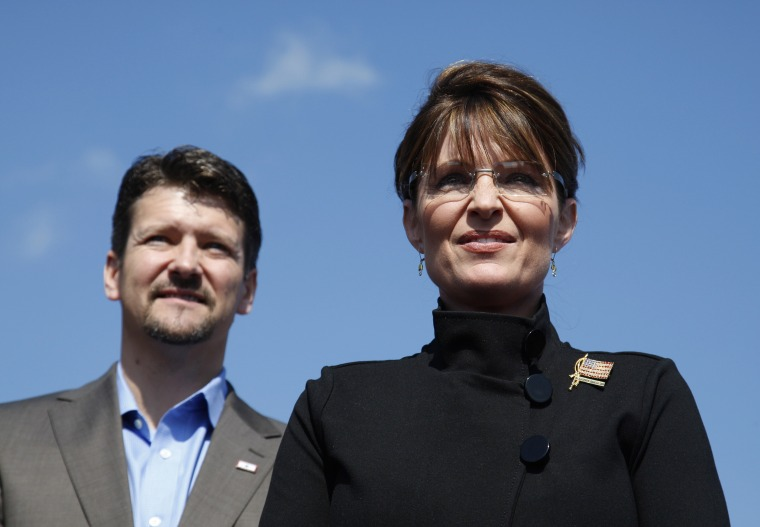 Image: Sarah Palin stands alongside her husband Todd during an outdoor campaign rally in Fairfax, Virginia, on Sept. 10, 2008.