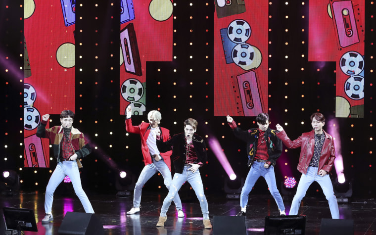 South Korean K-pop group SHINee performs during a showcase in 2016.