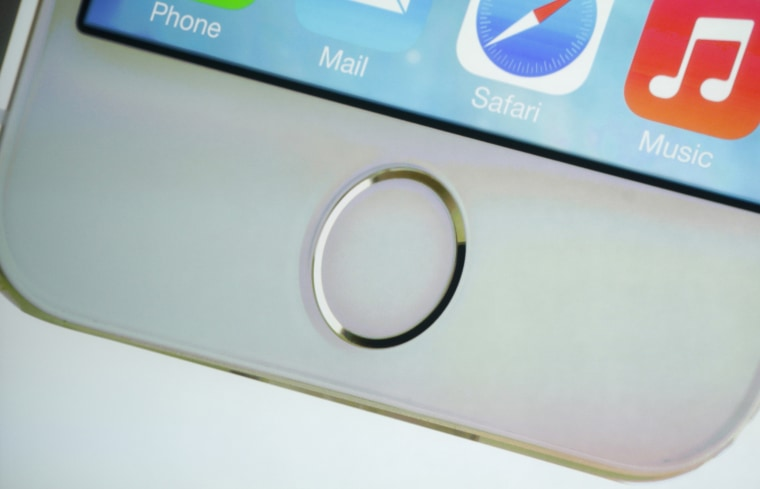 The home button which doubles as a fingerprint sensor is seen on an image of the new iPhone 5S at Apple Inc's media event in Cupertino