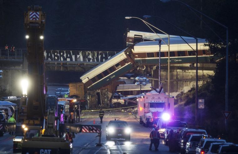 Image: Amtrak Train Derailment South Of Tacoma, Washington Leaves Train Car Dangling Onto Highway
