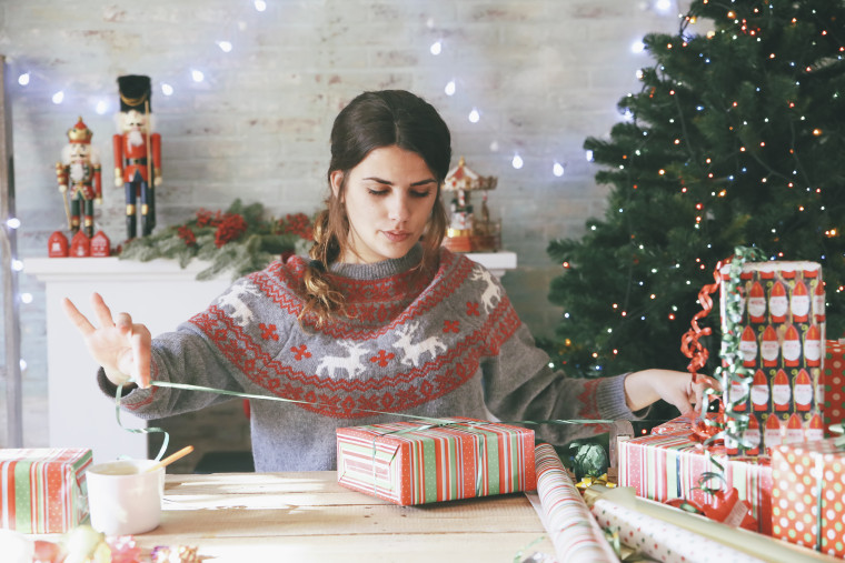 Image: Woman wrapping Christmas gifts
