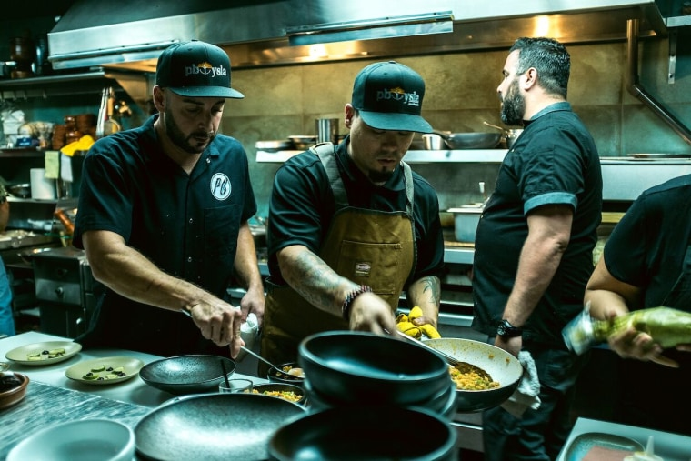 A picture of chef and restaurateur Jose Mendin and his staff at the kitchen at PB Ysla, in Santurce, Puerto Rico.