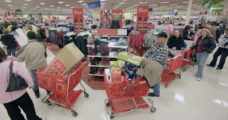 The line to check out winds through the store during the traditional Black Friday shopping day at the Target store in Mayfield Hts., Ohio on Friday, Nov. 27, 2009.   (AP Photo/Amy Sancetta)