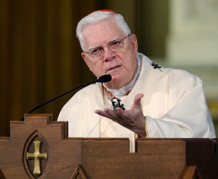 Image: Cardinal Bernard Law addresses the congregation at Holy Cross