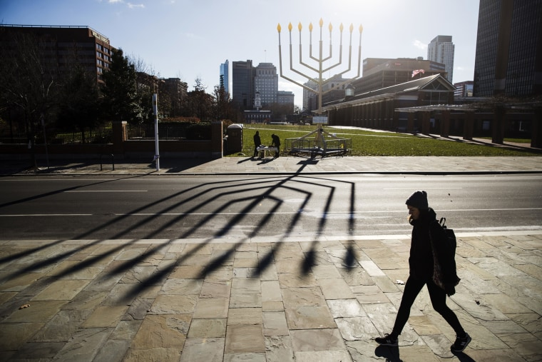 Image: A woman passes by a menorah on Independence Mall in Philadelphia