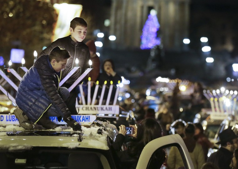 Image: Two young boys participate in the World's Largest Car Menorah Parade in Philadelphia