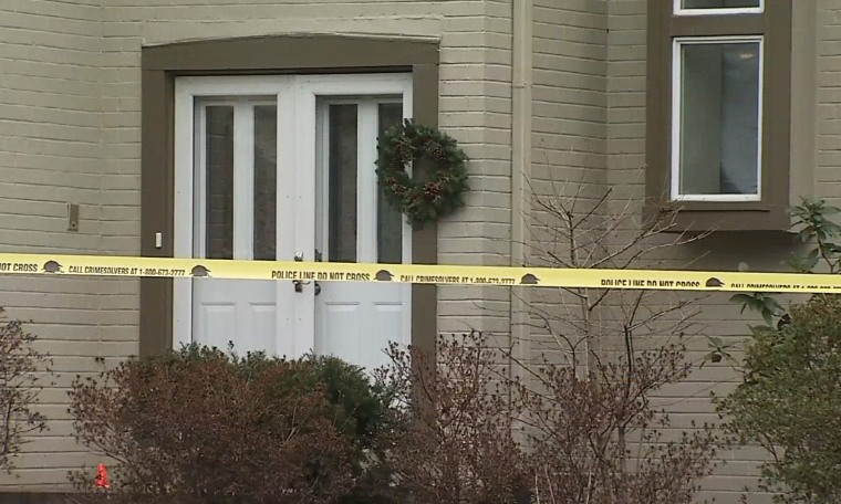 Image: Crime scene tape outside the home of Scott Fricker and his wife Buckley Kuhn-Fricker in Reston Virginia