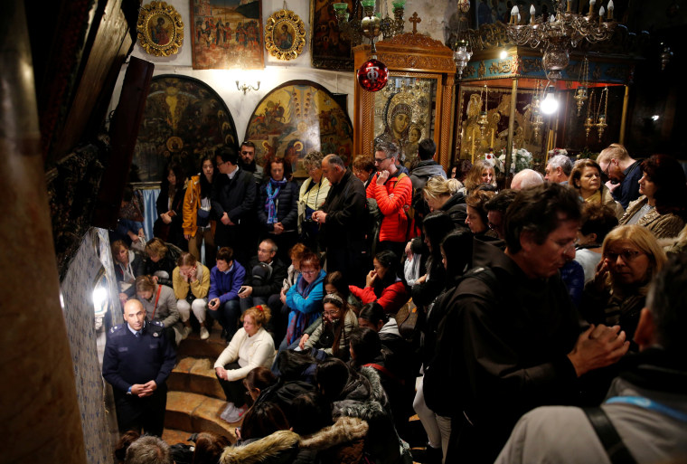 Image: Worshippers pray inside the Church of the Nativity during Christmas celebrations in the West Bank city of Bethlehem