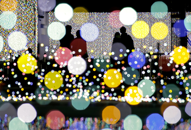 Image: Visitors view an illumination show at an amusement park on the outskirt of Tokyo