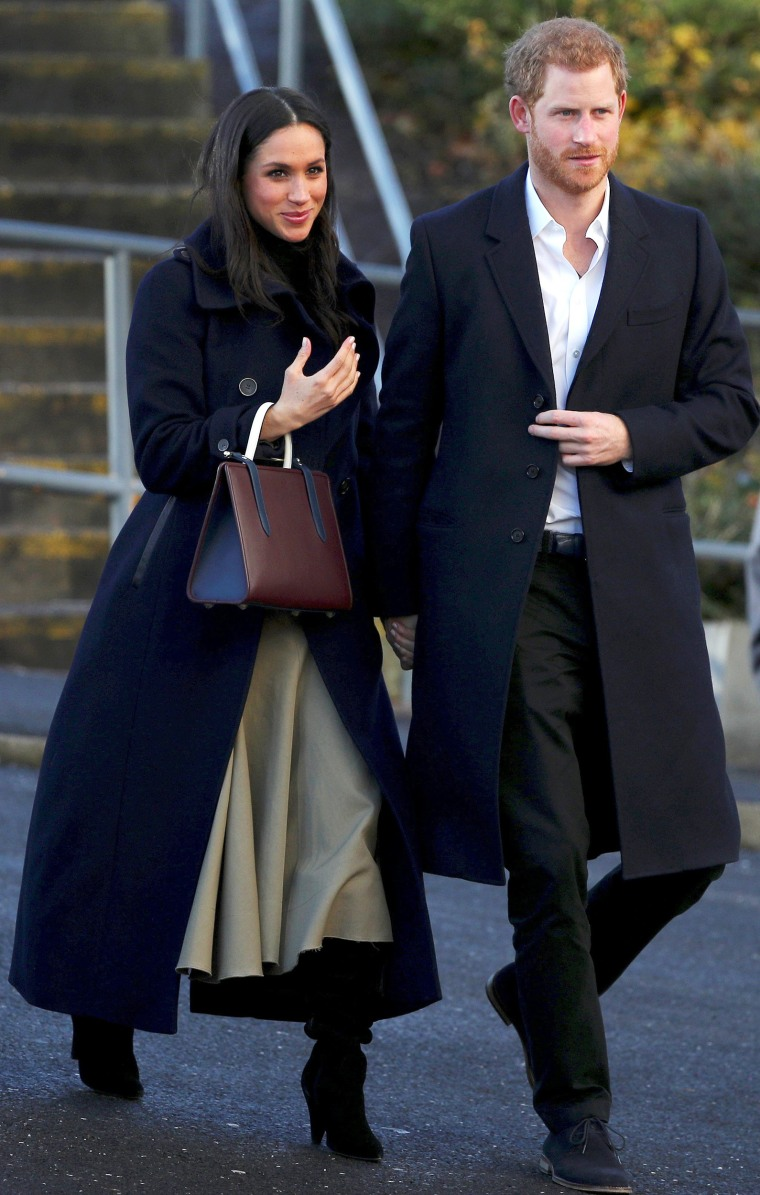 Image: Britain's Prince Harry and his fiancee Meghan Markle visit a school in Nottingham