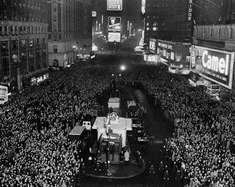In this view looking north from the New York Times building in New York, a crowd estimated at 500,000 gathers to usher in the new year, Dec. 31, 1940.  (AP Photo/John Lindsay)