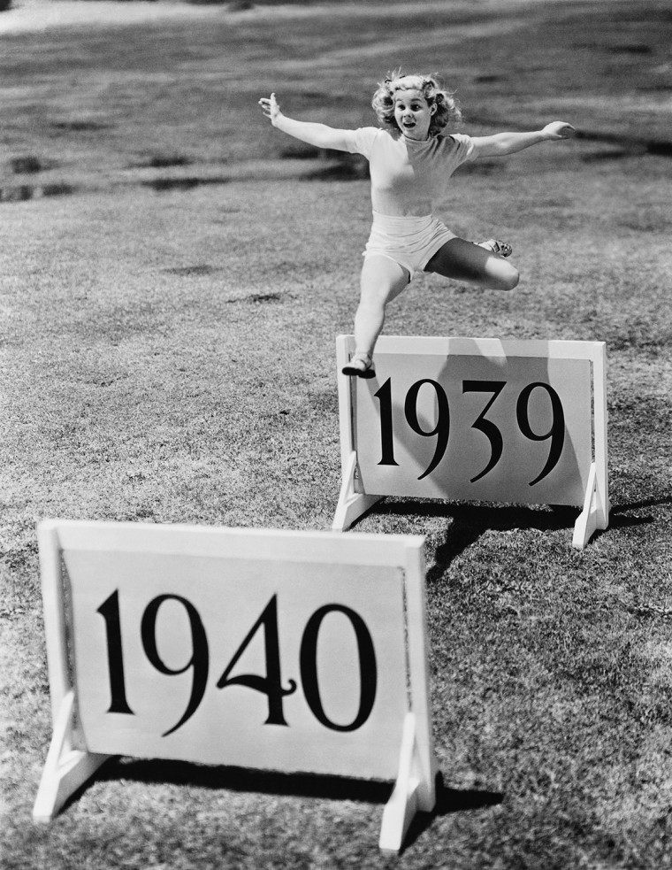 Woman jumping hurdles labeled with years (EV007227_H)