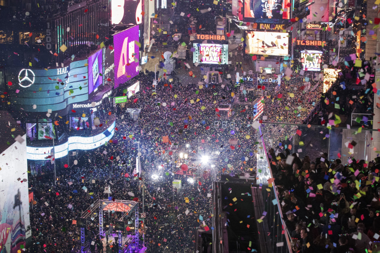 Revelers celebrate the new year as confetti flies over New York's Times Square as seen from the Marriott Marquis, Sunday, Jan. 1, 2017.