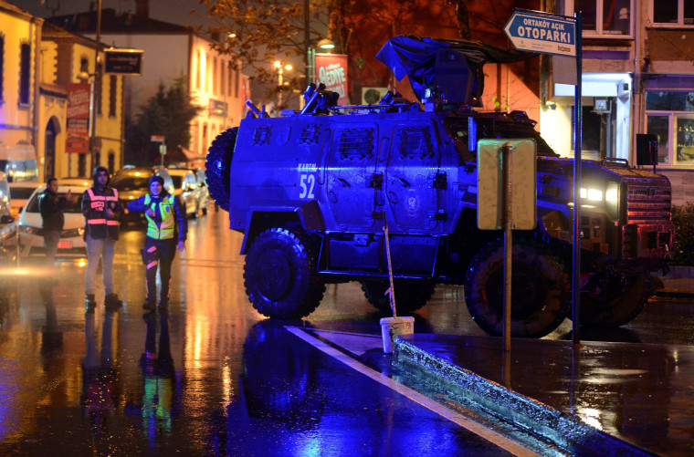 Image: An armoured police vehicle blocks a road leads to a nightclub where a gun attack took place during a New Year party in Istanbul