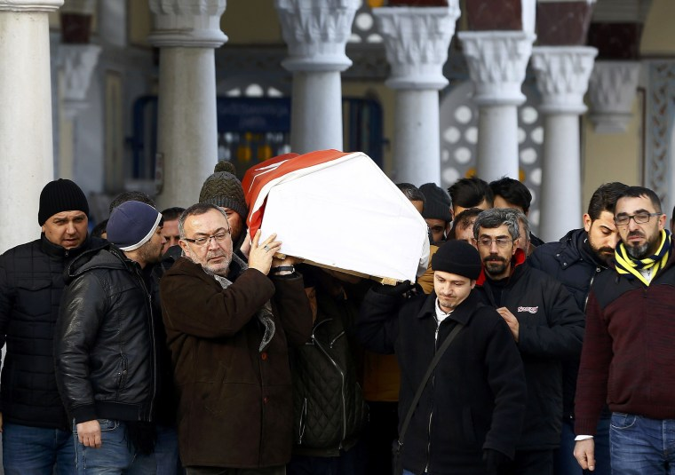 Image: Relatives carry the coffin of Arik, a victim of an attack by a gunman at Reina nightclub, during his funeral in Istanbul