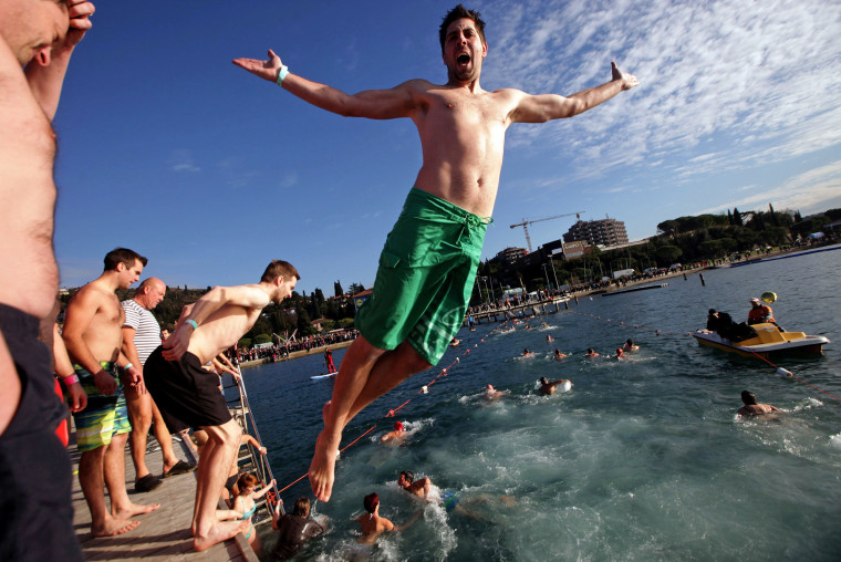 Image: Revellers take part in New Year's Jump into the Sea in Portoroz