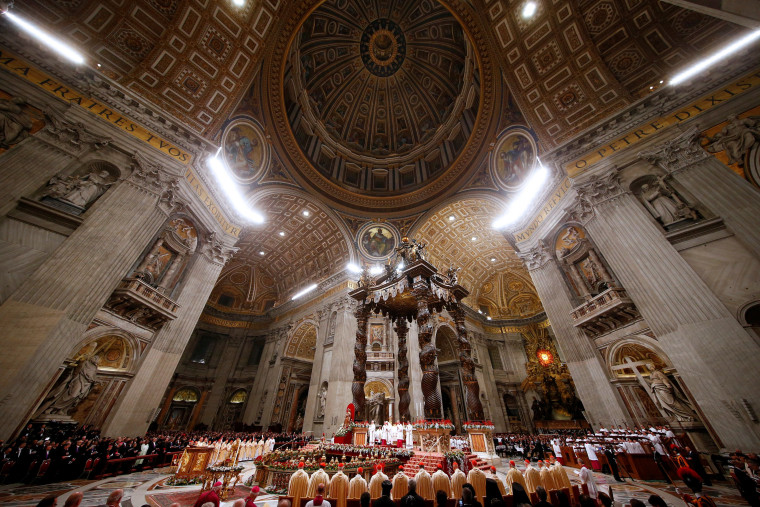 Image: Pope Francis leads the Christmas night Mass in Saint Peter's Basilica at the Vatican