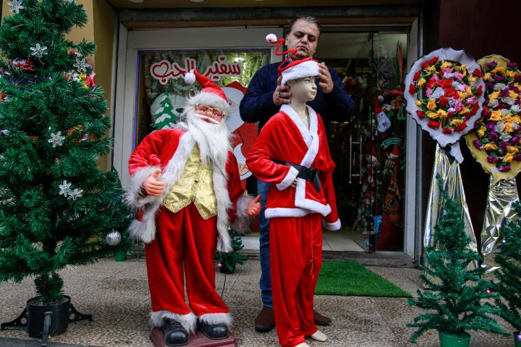 Image: A Palestinian shop keeper dresses plastic models