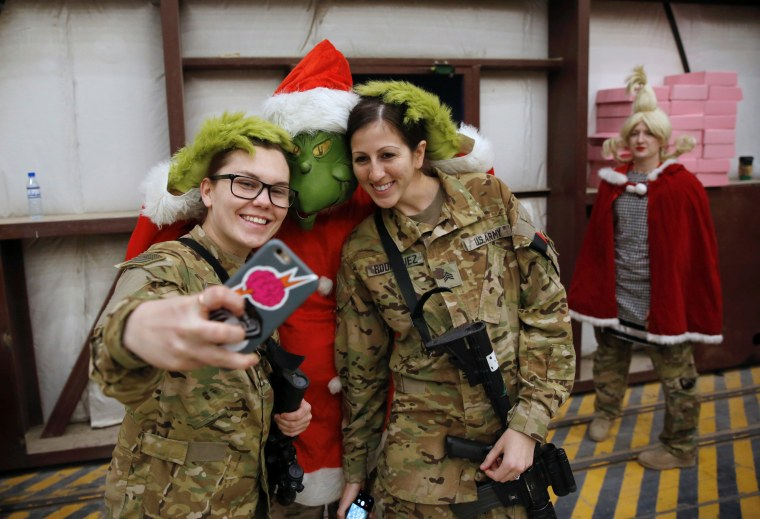 Image: Members of the U.S. army take picture during celebrations on Christmas Eve at a U.S. airfield in Bagram