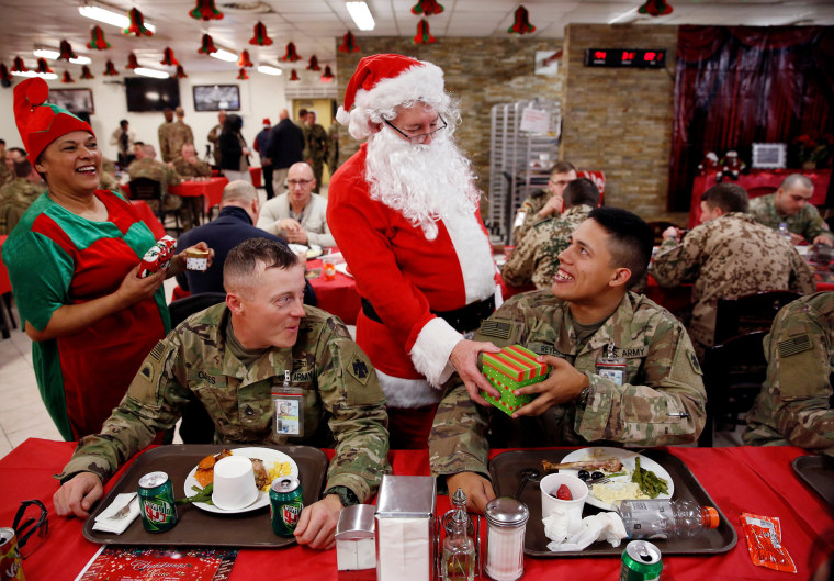 Image: A member of the U.S. Army receives a gift from Santa