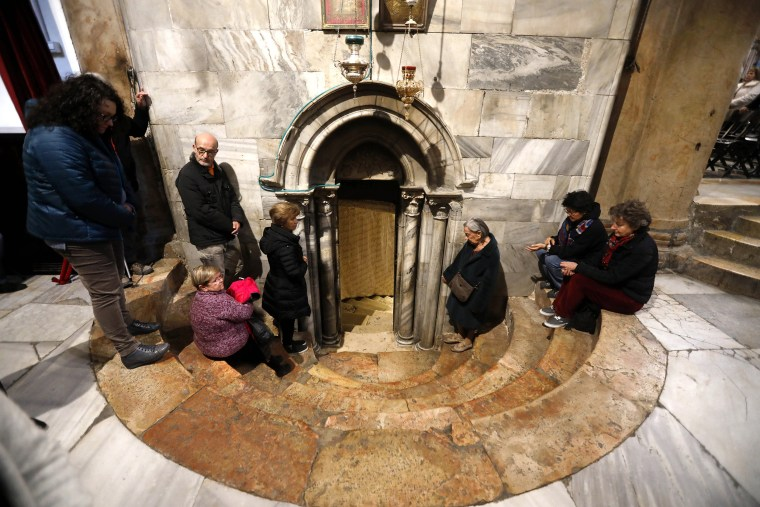 Image: Christian worshippers pray at the Church of the Nativity