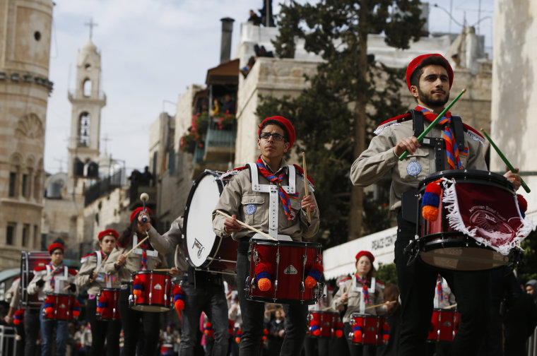 Image: Members of a Palestinian marching band parade during Christmas celebrations