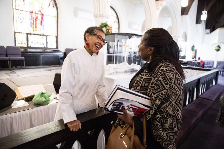 Image: Pastor Gloria White-Hammond speaks with parishioner Joyce Sackey Acheampong