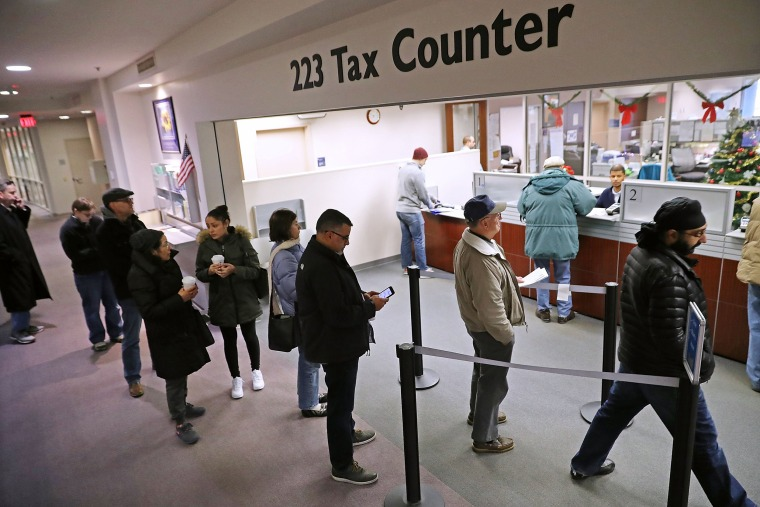 Image: Taxpayers Line Up To Pre-Pay Property Taxes Ahead Of New Tax Law Limits
