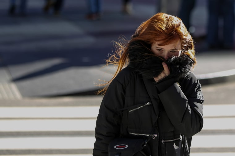 Image: A Woman Bundles Up Against the Cold Temperature
