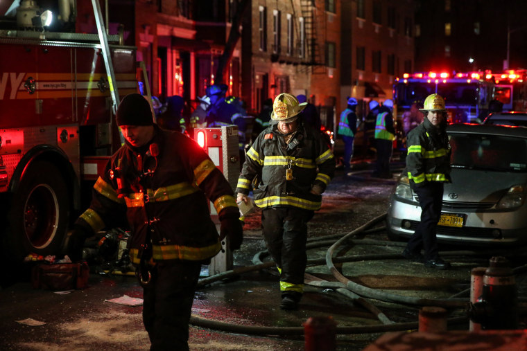 Image: FDNY personnel work on the scene of an apartment fire in Bronx