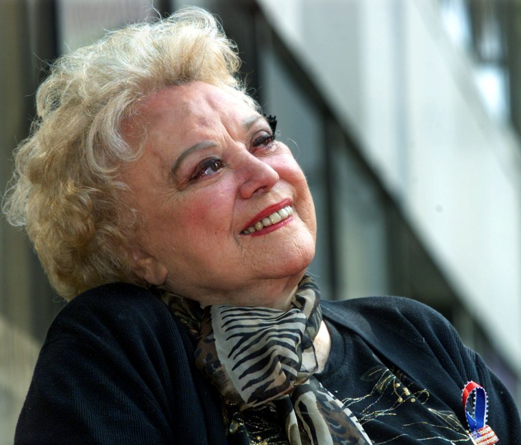 Image: FILE PHOTO -  Actress Rose Marie smiles as she listens to Carl Reiner recount their experiences together during ceremonies to honor her with a star on the Hollywood Walk of Fame in Hollywood