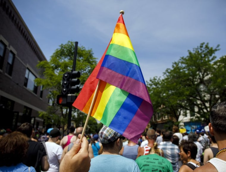 In this June 11, 2017 file photo people attend the LGBTQ Chicago Equality rally in the Andersonville neighborhood of Chicago.