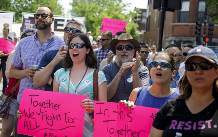 In this June 11, 2017 file photo, people attend the LGBTQ Chicago Equality rally in the Andersonville neighborhood of Chicago.