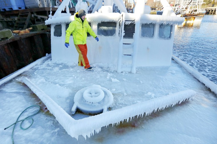 Image: With temperatures in the single digits, Ray Levesque, mate of the crab/lobster boat Bradbill