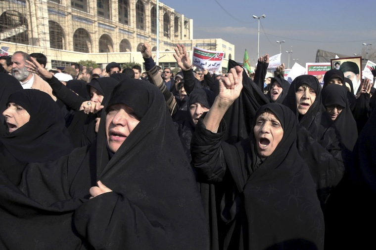 Image: Iranian protesters chant slogans at a rally in Tehran, Iran